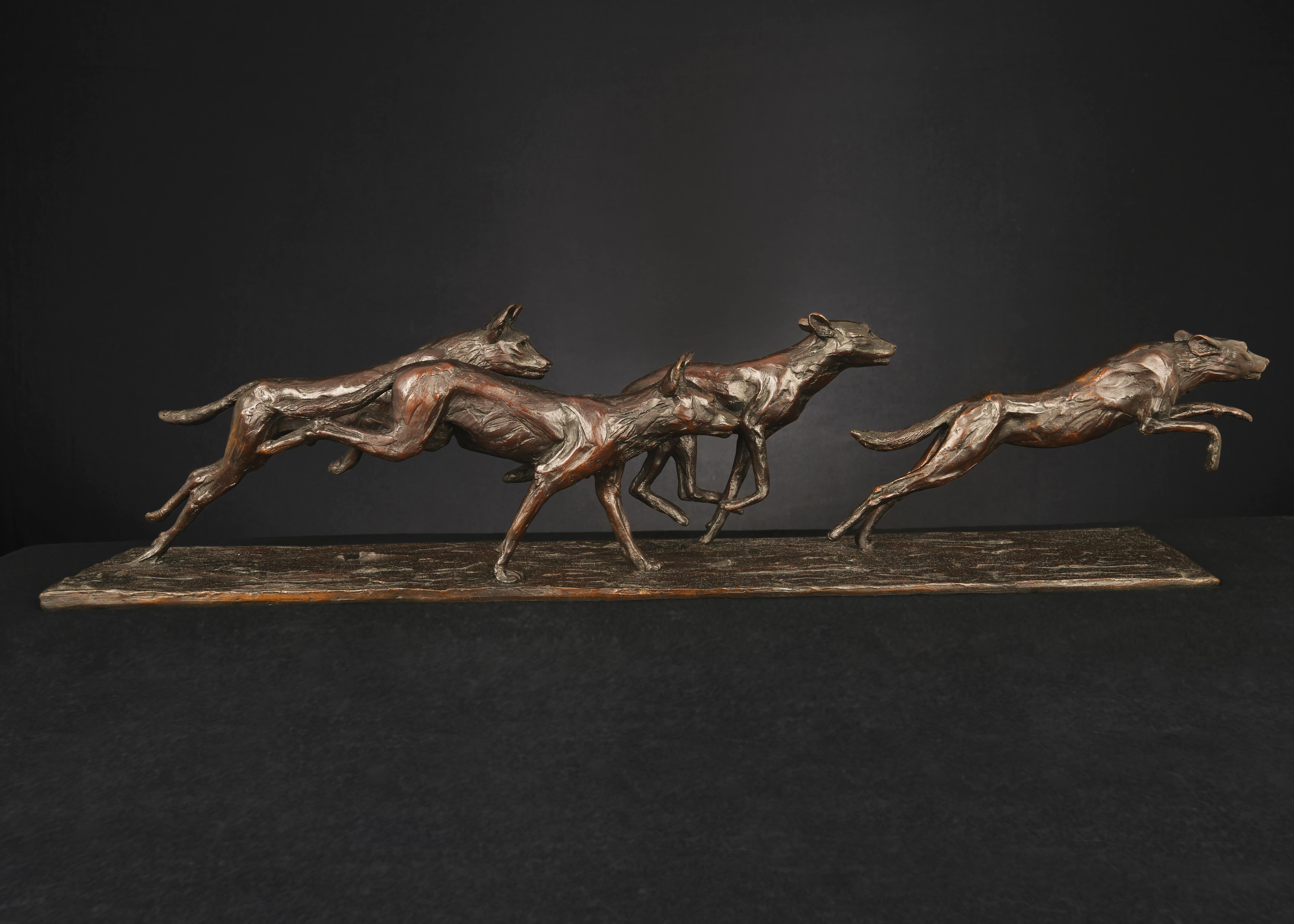 Bruce Little, bronze sculpture of a pack of wild dogs on the hunt
