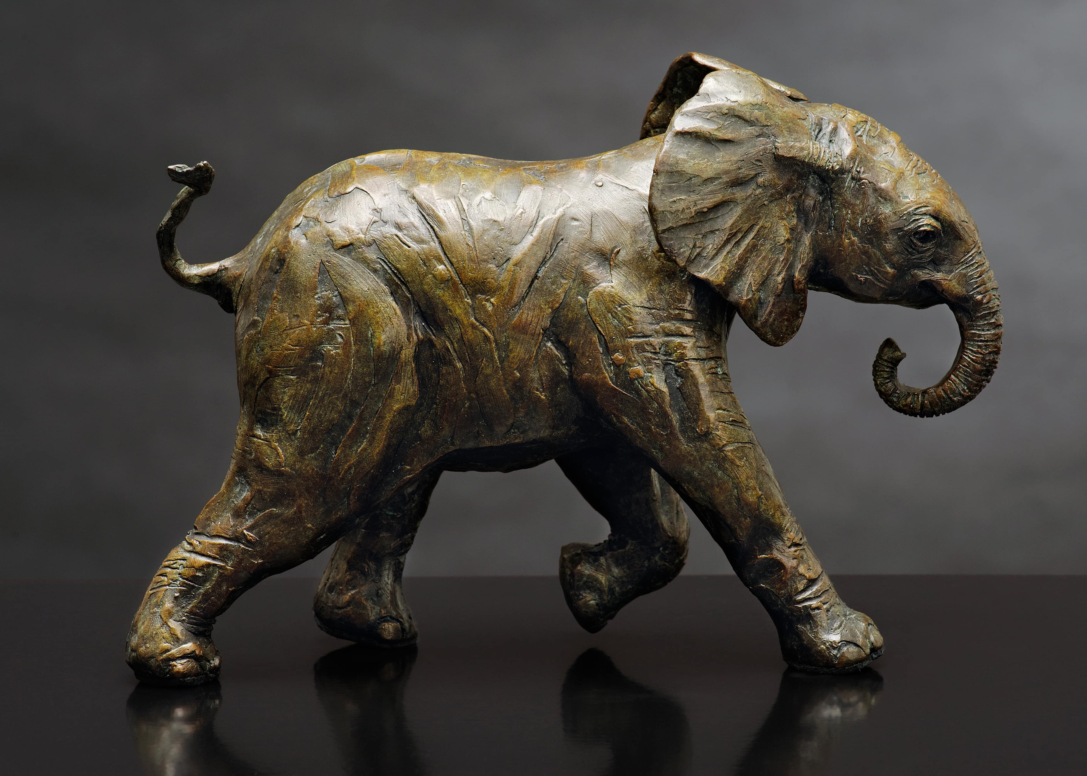 Bruce Little, bronze sculpture of a young elephant, Youthful Exuberance II